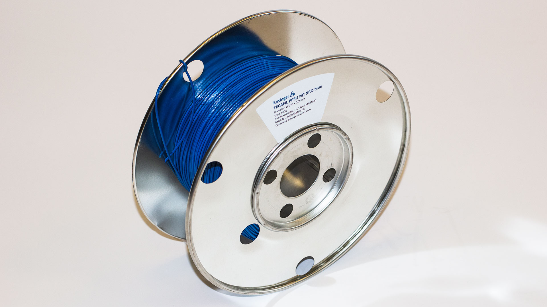 Filament spool loaded with blue PPSU