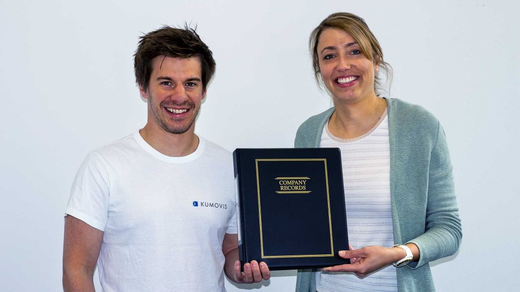 Kumovis co-CEOs Stefan Leonhardt and Dr Miriam Haerst showing documents of incorporation in the USA